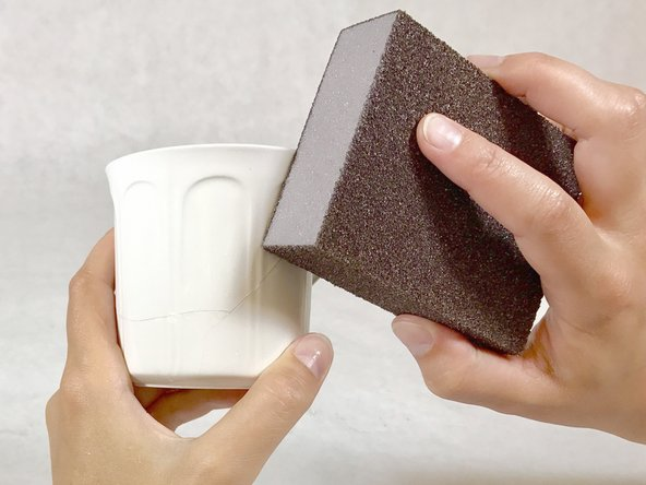 Use coarse sandpaper to further reduce the excess epoxy.