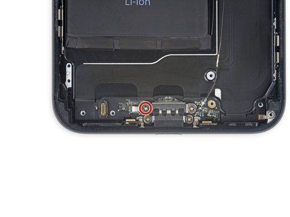 Remove the 2.9 mm Phillips screw at the top left of the Lightning port.