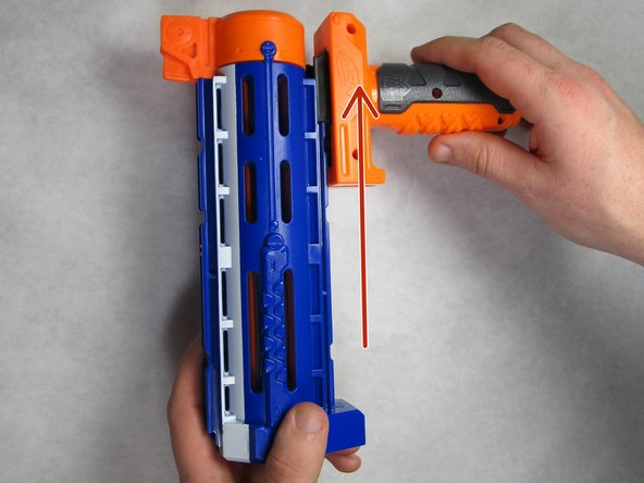 Slide the hand grip assembly toward the end of the barrel and off the barrel assembly.