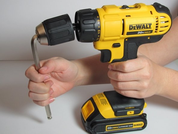 Using your dominant hand, turn the Allen Wrench towards you until the chuck removes itself completely from the drill.