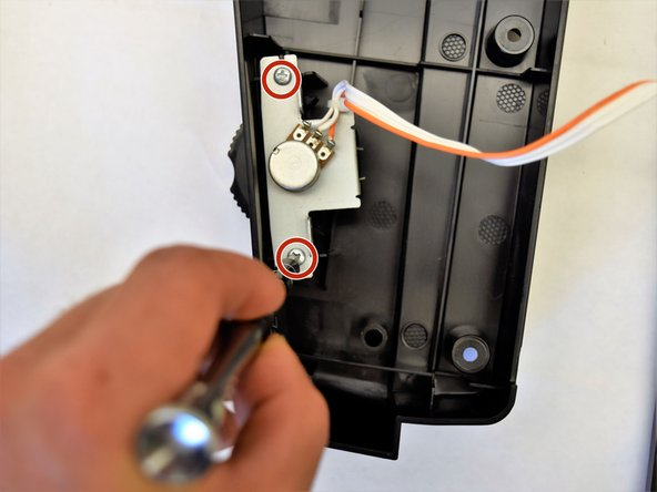 Remove the two 8mm x 1.5mm J screws from the inside of the side panel by using a J1 head screwdriver.