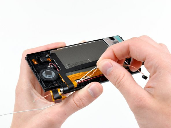 Using your fingers, grasp the microphone cable and remove it from the front bezel assembly.