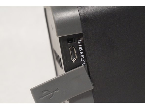 Make sure there is no unwanted debris located in the USB charging port and the hole that holds the protector in place.