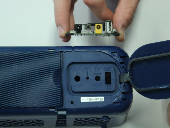 Once the black casing has been removed, you can pull the auxiliary port out of the inside of the speaker.