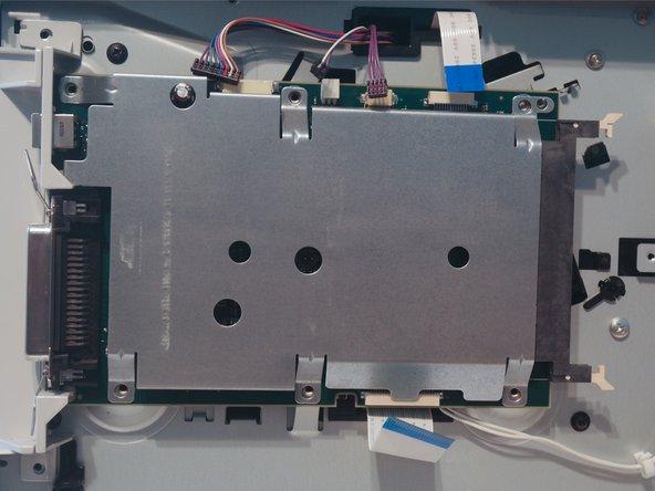Remove 2 screws on the I/O port cover.