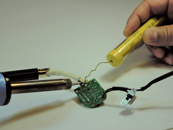 To reattach the new temperature control switch, solder the piece onto the board.