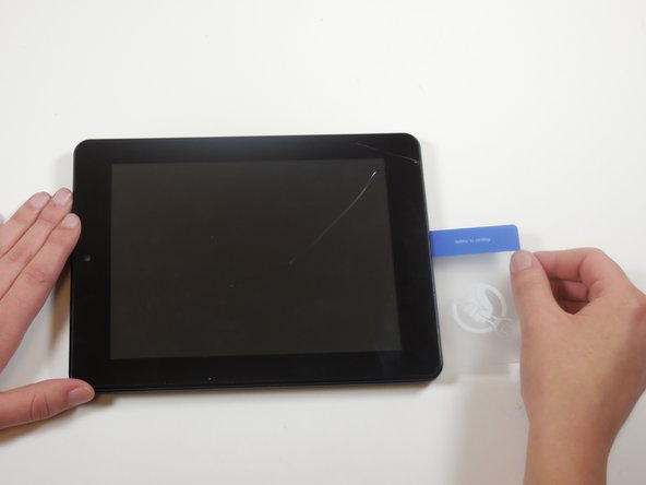 Image 1/2: Run this object around the perimeter of the tablet until there is separation between the casing and the screen.