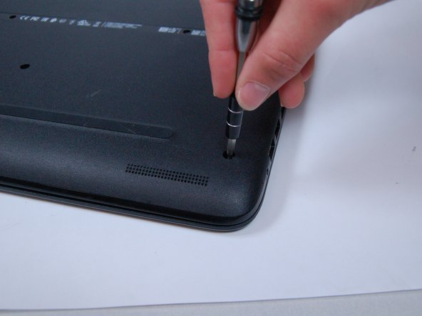 Using a Phillips Head Screwdriver, remove the screws anchoring the bottom casing.