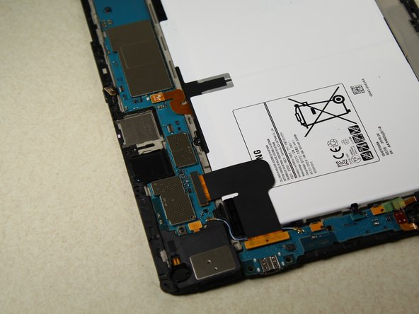Remove the 4  black 3.0 mm Phillips head screws from the corners of the battery housing using the screwdriver.