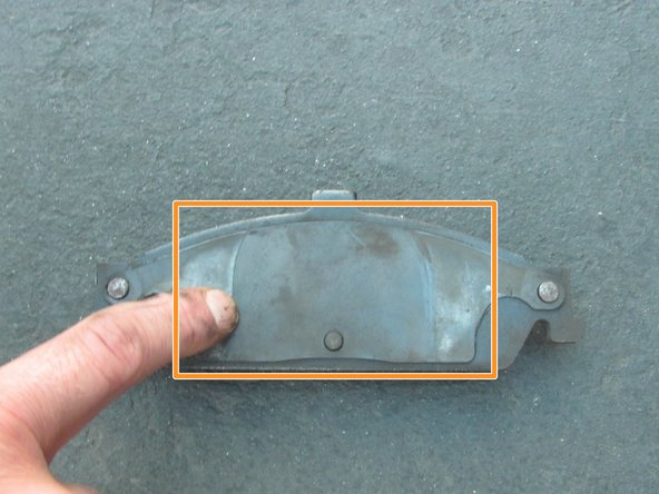 "Image 3/3: Before putting the new brake pads on, apply ""Disc Brake Quiet"" compound to the metal backing of the pads to keep them from squeaking."