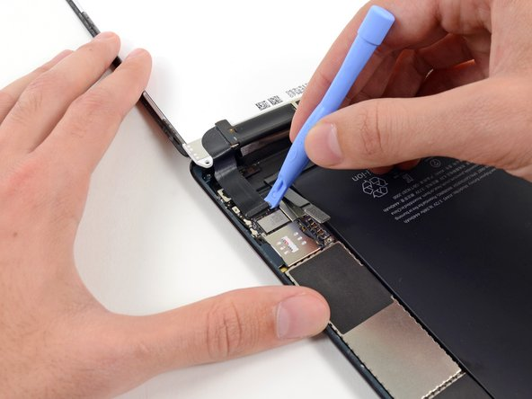 Use a plastic opening tool to pry the LCD connector from its socket on the logic board.