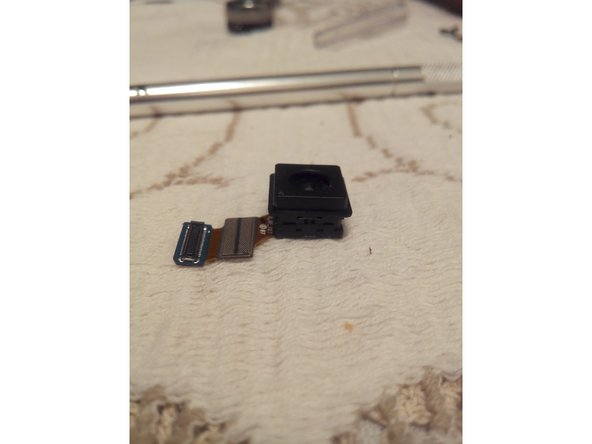 After removing the black tape, we are left with a single clip on each side of the camera.