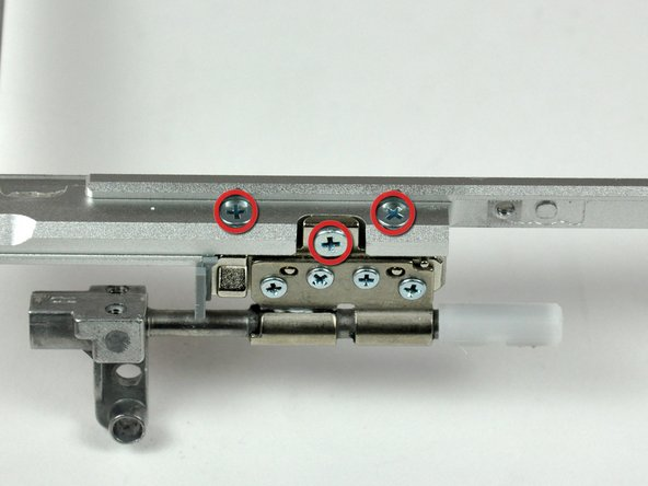 Image 1/2: Remove the right clutch hinge and set it aside.