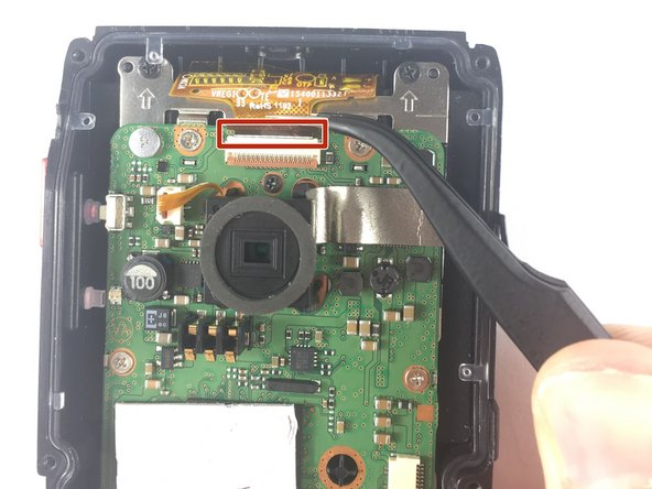 Use precision tweezers to remove the connector joining the LCD and the motherboard.