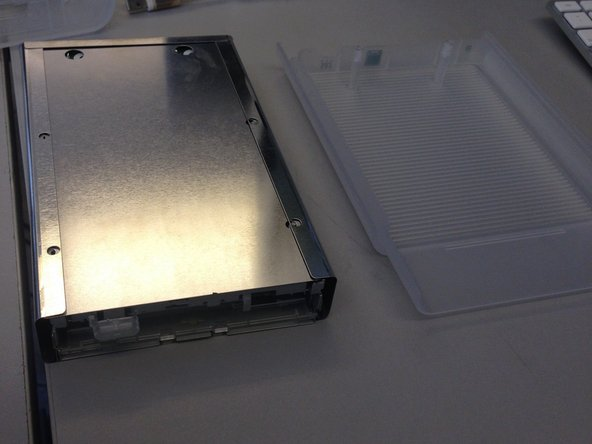 Slide the metal housing out of the plastic shell.