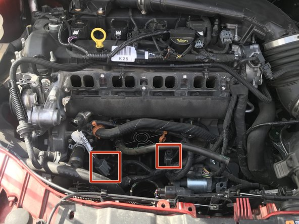 Unplug both left and right engine ground strap connections.