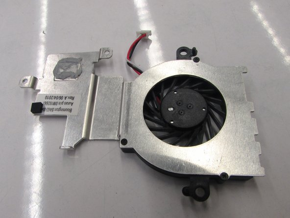 Remove the metal casing with the  fan attached  from the motherboard.