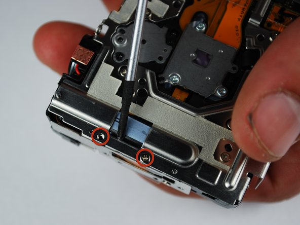 Begin by removing two silver  0.080in screw on the left side of the camera.