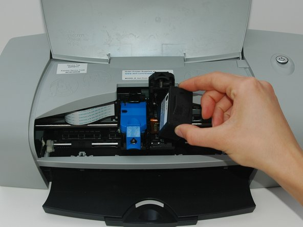 Grab the ink cartridge and remove it from the printer.