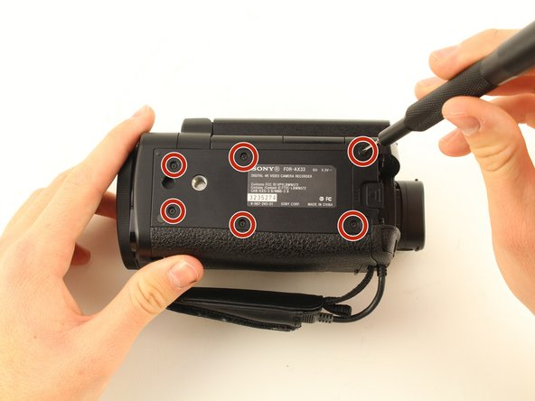 Remove the battery by pushing the latch towards the body of the camera. Push the battery down and pull it out.
