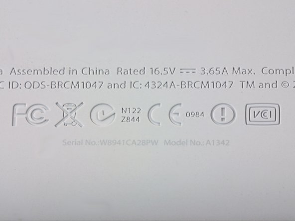 Image 1/1: Unfortunately, Apple only allows those with 20/20 vision to find out their model and serial number. That text is incredibly tiny and difficult to read.
