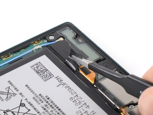 Use a pair of tweezers to pull out the second adhesive strip from underneath the battery.