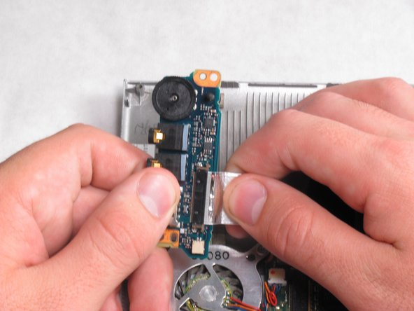 Remove the ribbon cable from the port to free it from the laptop.