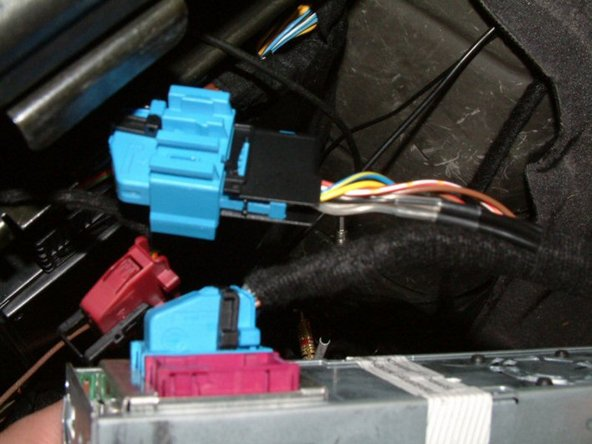 Image 2/3: Disconnect Blue power plug simply by pressing down on the release tab on top holding the black locking lever.