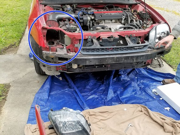 When removing the headlight, take care to avoid touching any bulbs with your hands or wear a latex glove. Furthermore, do not force the assembly to come out. If the assembly does not come free with a gentle pull then something is likely still attached.