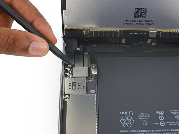 Image 1/3: Use the pointed end of a spudger to disconnect the digitizer cable connector from its socket on the logic board.