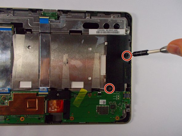 Use the +J000 screwdriver to remove two screws from each speaker.