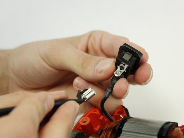 Push the security pin with the plastic spudger and simultaneously, pull gently on the cable to separate it from the button