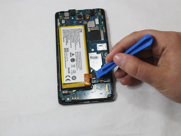 Use a plastic opening tool to lift the press-fit connector up and disconnect the battery ribbon cable.