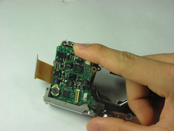 Now the motherboard can be gently removed from the metal casing.