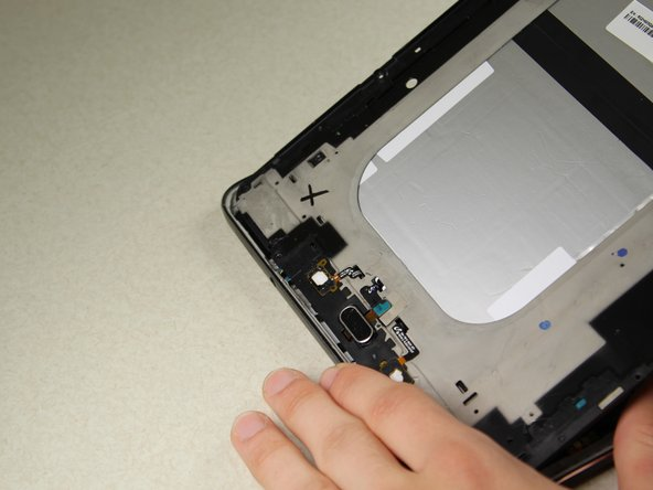 Pull towards the top of the device as you lift out to ensure that the charging port connection is not damaged.
