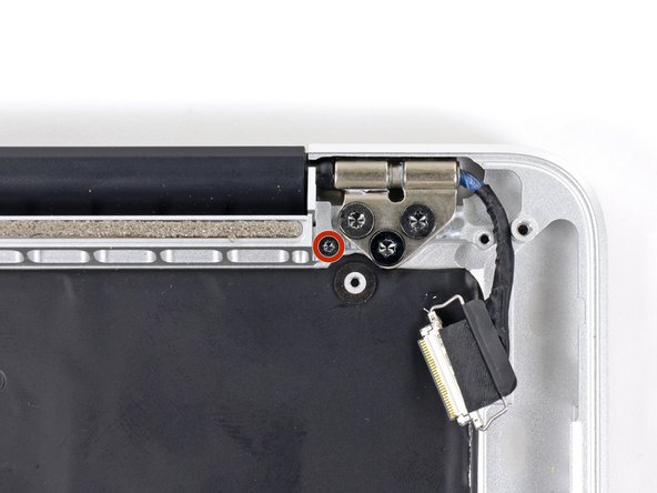 Image 2/2: Remove the 3.2 mm T5 Torx screws (one on each side) securing the aluminum hinge brackets to the upper case.
