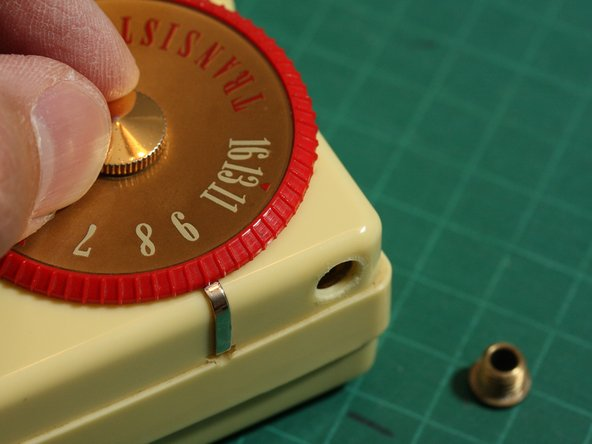Image 1/2: ...and then you can remove the screw and lift off the tuning dial.
