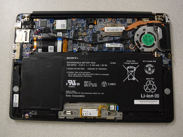 Lift up back cover to access internal components of the laptop