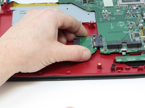 Use the Phillips #0 Screwdriver to remove the two 4mm screws that are holding the SATA connector in place.