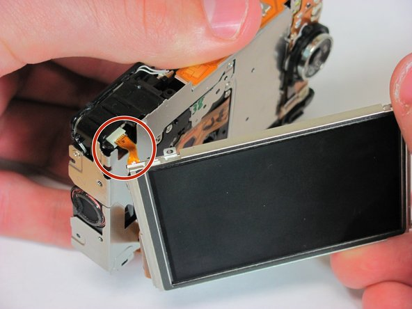 Locate the two ribbons connected to the camera and the LCD screen. (One is red and small and the other is  wide and orange)