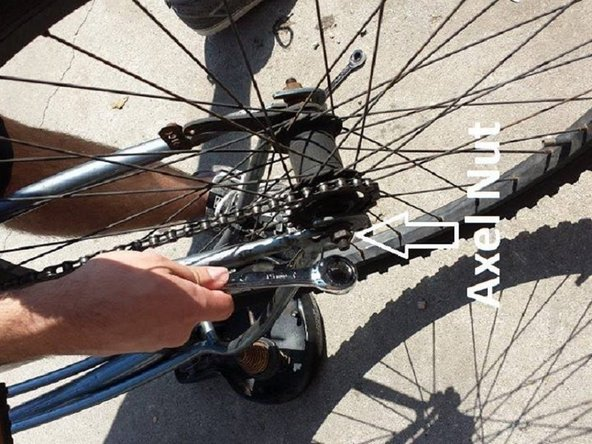 Image 1/1: Wheel will angle as you tighten. Keep it centered with your hand as you finish tightening both axle nuts.