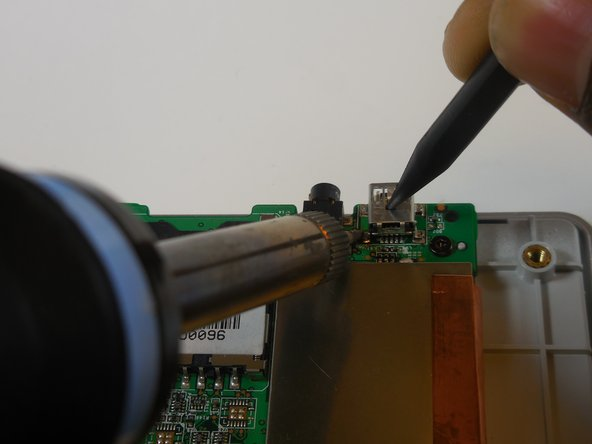 Image 3/3: Don't touch the charger port with your hands, it may have heated up during soldering.