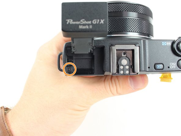 Image 2/2: Remove the 2.5mm screw to the left of the flash.