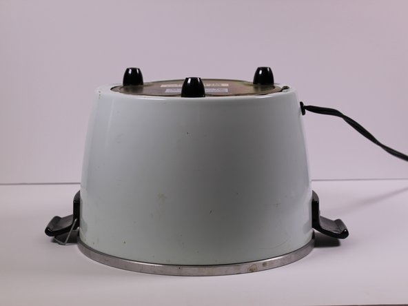 Flip the rice cooker device upside down.