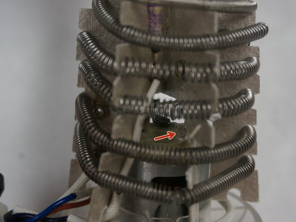 The fan/motor assembly is connected to the heating element assembly at two points need to be desoldered. After pulling the attached wires through the holes the fan/motor assembly will be free from the heating element assembly. Congratulations you have now completely removed the fan/motor assembly from this hair dryer!