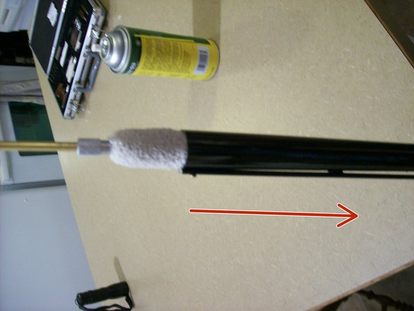 Detach the wire brush from the ramrod and attach the 12 gauge cotton mop.