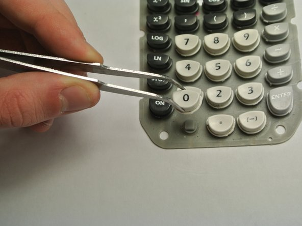 Lift the tweezers to remove the individual key.