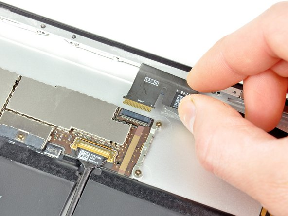 Pull the headphone jack and front camera ribbon cable straight out of its socket on the logic board.