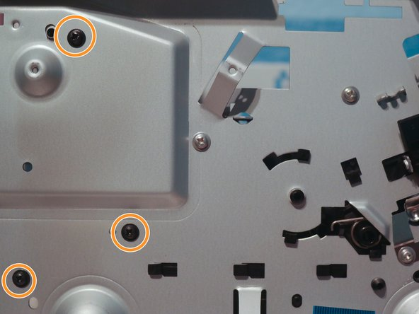 Remove 3 screws from the left side of the printer.
