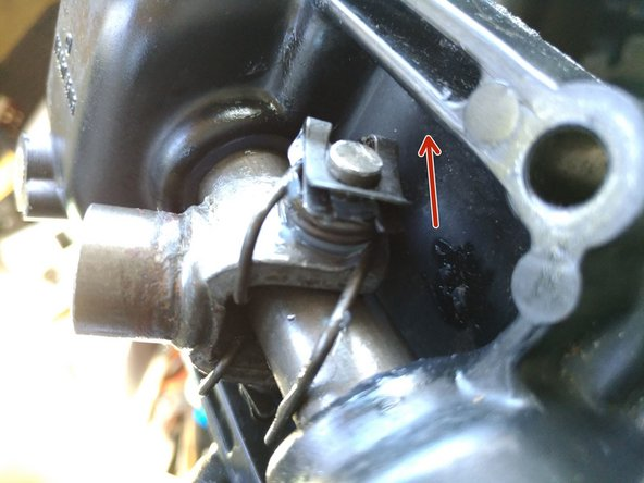 Remove a clip from one end of the small rod connecting the shift lever yoke to the main rod